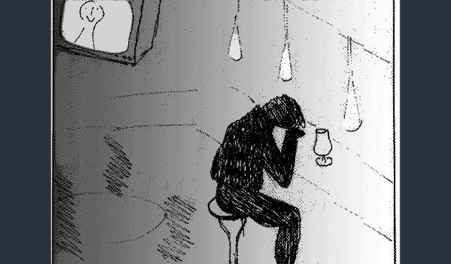 Mann sitzt vor Kneipentheke und sieht deprimiert aus
